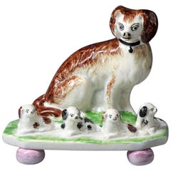 Antique English or Scottish Pottery Figure of a Spaniel with Four Pups on Bases