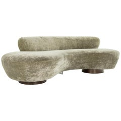 Curved Sofa on Walnut Bases by Vladimir Kagan