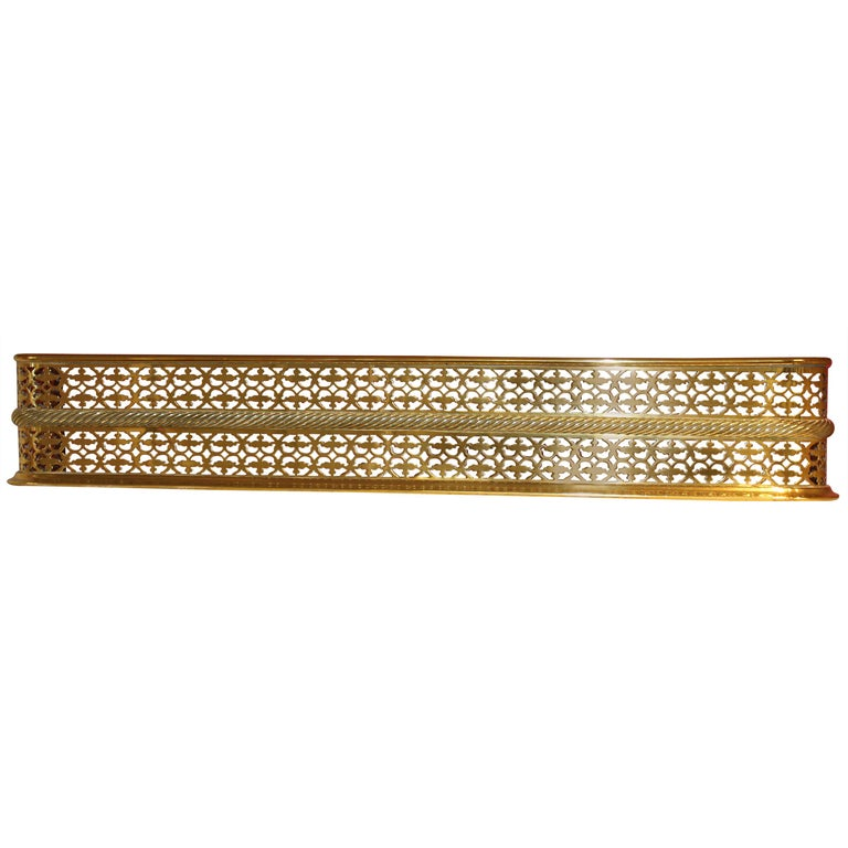 Antique English Georgian Style Pierced Brass Fireplace Fender with Rope Motif For Sale