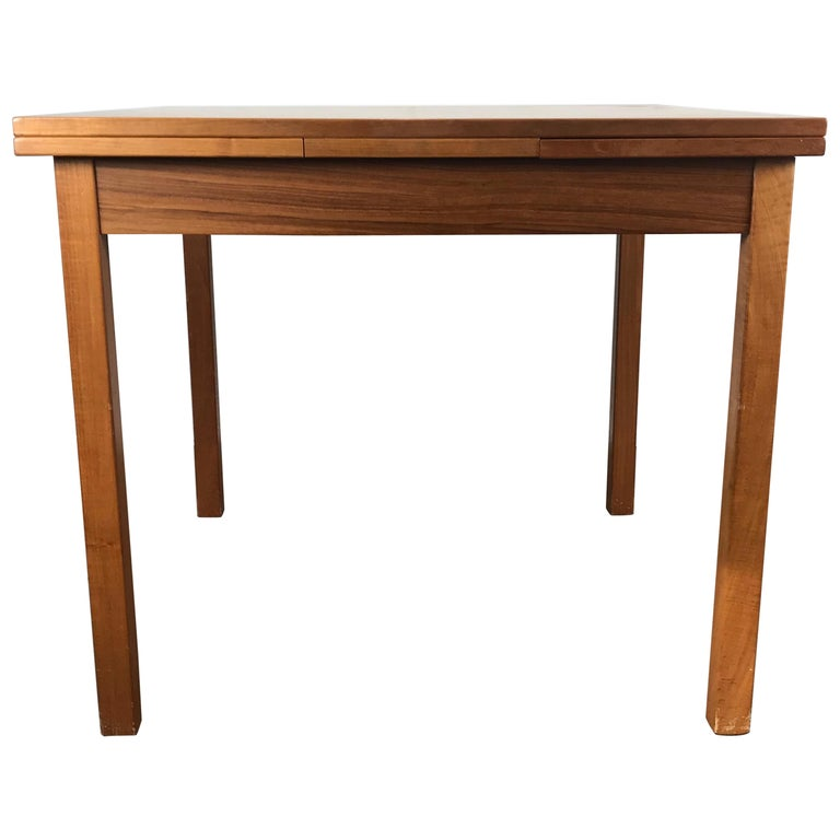 Sleek, Simple Expandable Teak Dining Table Made in Denmark For Sale