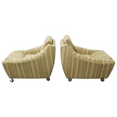 Pair of Norwegian Sculpted Lounge Chairs