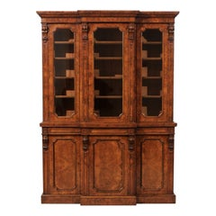 English 1880s Burled Walnut Breakfront Bookcase with Glass Doors and Volutes
