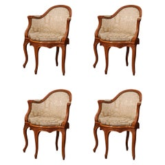 Set of Four Early 20th Century French Louis XV Carved Walnut Desk Armchairs