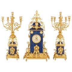 French Gilt Bronze-Mounted Lapis Lazuli Mantel Clock Set