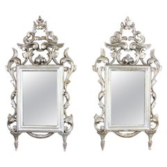 Pair of 19th Century Spanish Rococo Style Silver Leaf Carved Wood Mirrors
