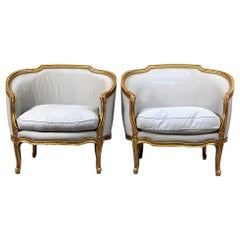 Interesting Pair of Late 19th Century Louis XV Style Giltwood Bergeres