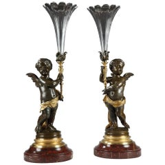 Pair of Cupids Holding Trumpet Vases by V. Paillard