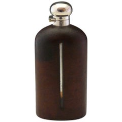 Large Leather Covered Glass Hip Flask with Silver Plated Top, circa 1900