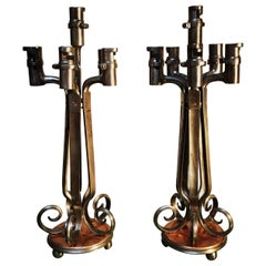 Pair of Bayonet Polished Steel and Copper Candelabra