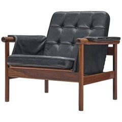 Illum Wikkelsø Lounge Chair in Original Black Leather and Rosewood, 1960s