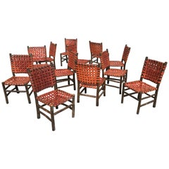 Twelve Old Hickory Dining Chairs with Woven Cognac Saddle Leather