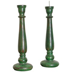 Pair of French LPhilippe Style Turned and Green Painted Wooden Candlesticks