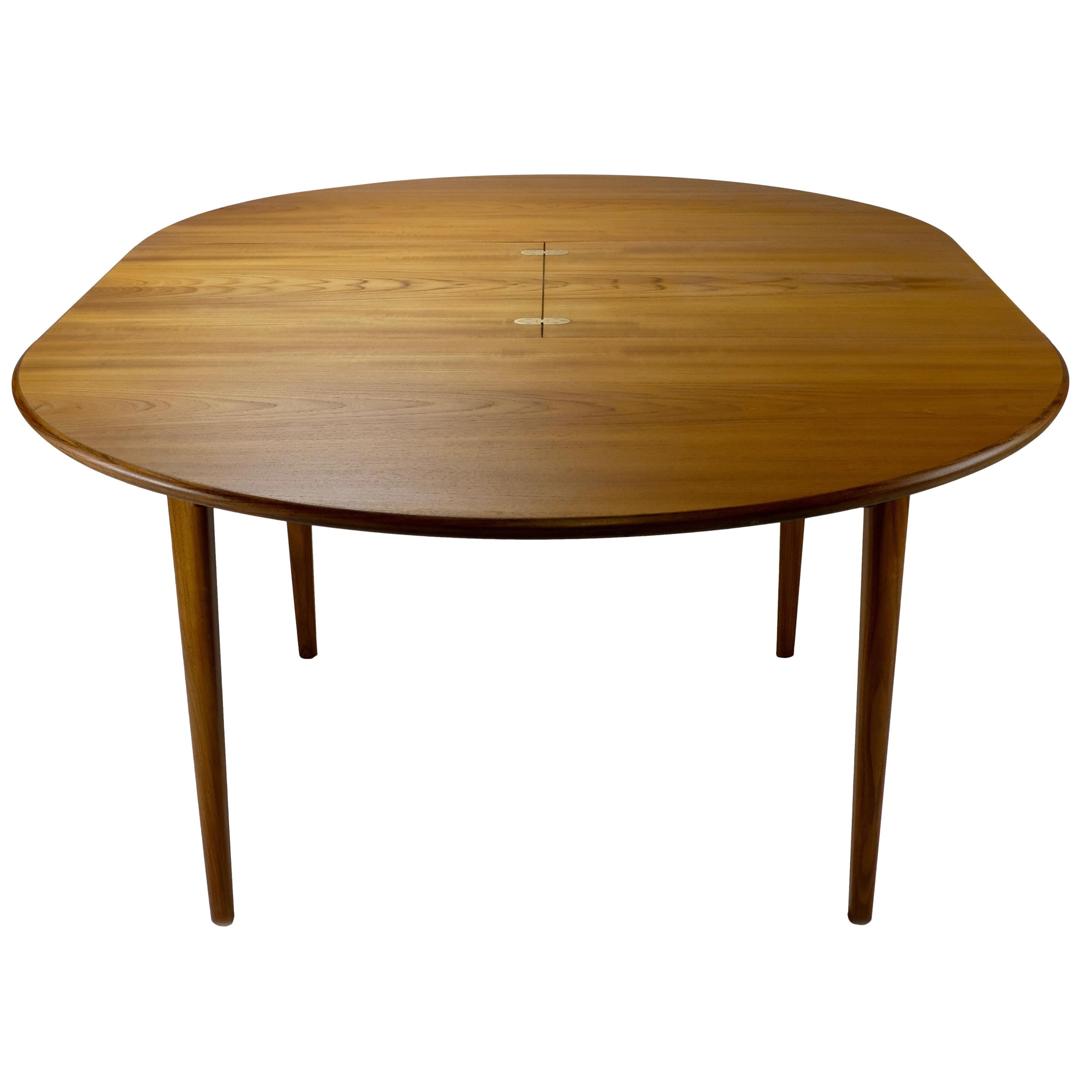 Danish Modern Teak Round Dining Table With Butterfly Leaf For Sale At 1stdibs