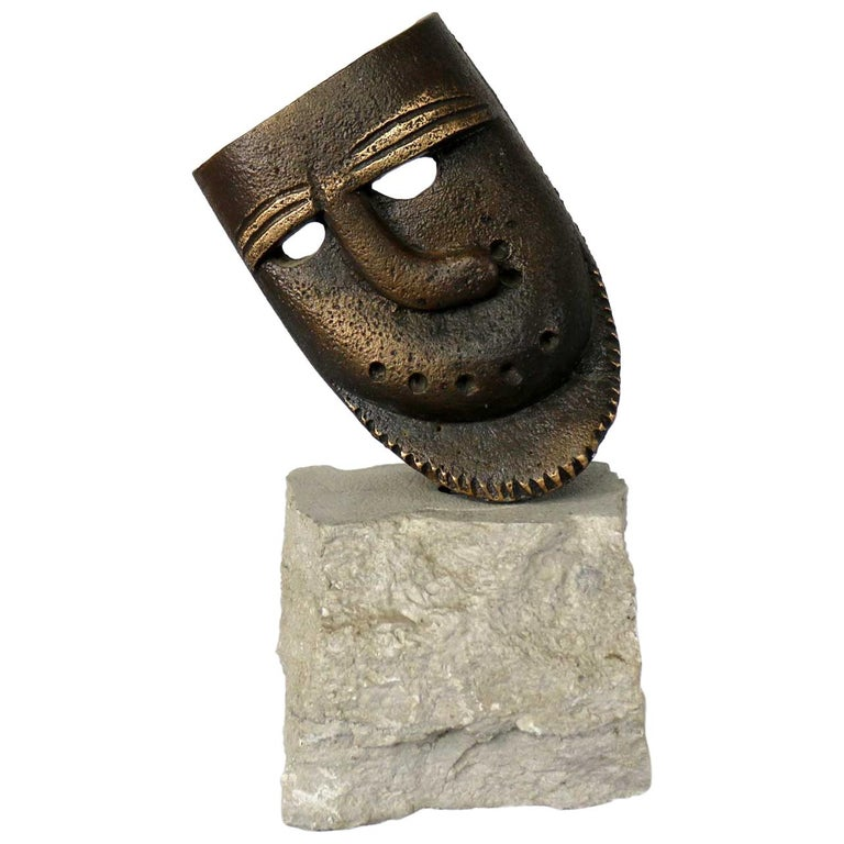 Cast Bronze African Mask Sculpture with Crooked Nose Mounted on Limestone Stand For Sale
