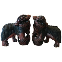 Pair of Carved Wood and Lacquered Foo Dogs