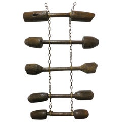 Wall Hanging of Antique Wooden Pestles