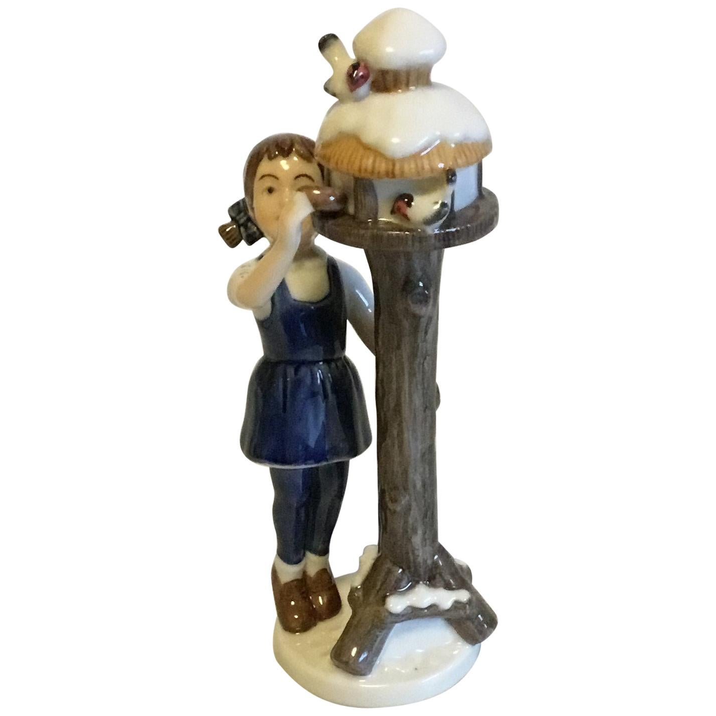 Royal Copenhagen Figurine of Girl by Bird Feeder No 757
