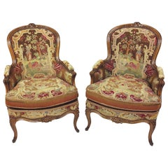 Fine Pair of French Carved Walnut Framed Fauteuils
