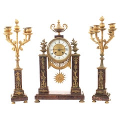 French Louis XVI Style Rouge Marble and Bronze Doré Clock Set