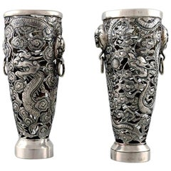 Luen Wo, Shanghai, a Pair of Dragon Vases in Silver, circa 1900