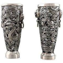 Luen Wo, Shanghai, a Pair of Dragon Vases in Silver, circa 1900