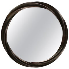 Wave series mirror in hard maple with satin brown varnish