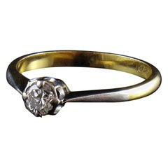18-Karat Gold Diamond Solitaire Engagement Ring in Classic Four Prong Setting