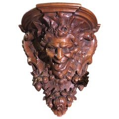 Late 19th Century Italian Hand Carved Walnut Shelf Depicting a Capricious Satyr