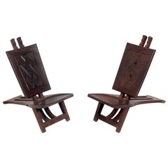 Pair of Low Slung Hand Carved African Lounge Chairs