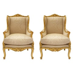 Pair of French 19th Century Louis XV Style Giltwood Bergères à Oreilles