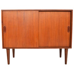 Danish Modern Small Teak Sliding Door Credenza