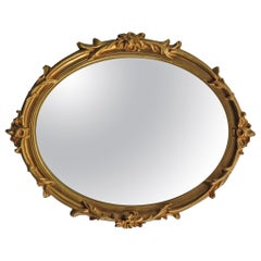 Oval Wall Mirror with Rococo Gold Finish Frame of Gesso on Wood, circa 1930
