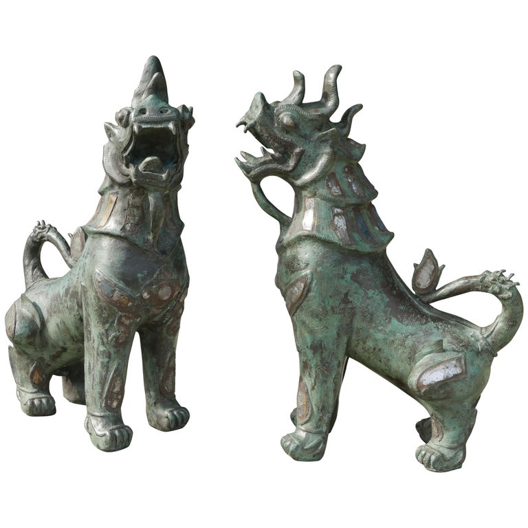 Tony Duquette Style Thai Bronze Foo Dogs Inset with Antique Mirrors and Agate For Sale