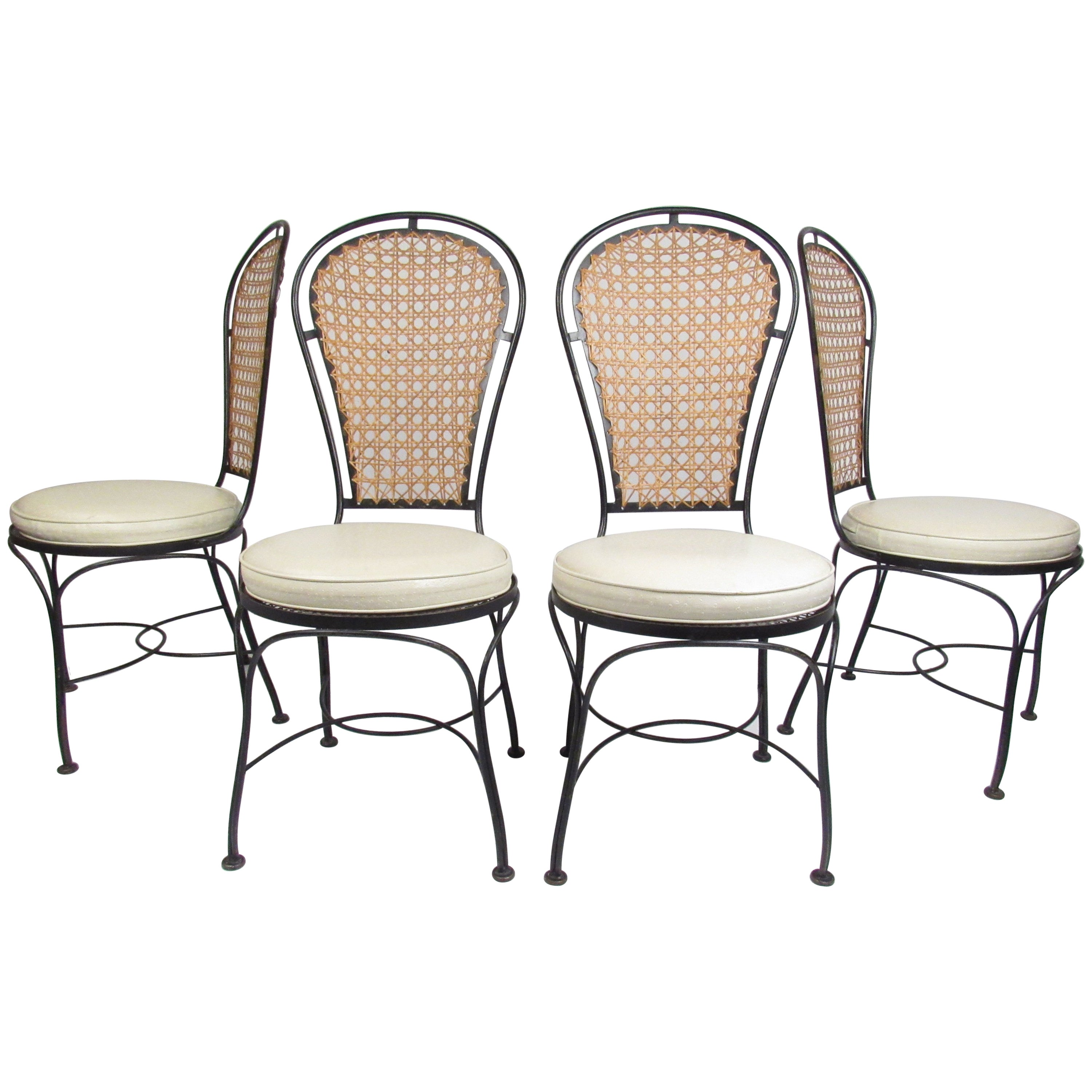 Set of Four Midcentury Wrought Iron Dining Chairs with a Cane Backrest