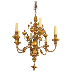 Stunning Giltwood Italian Chandelier of Metal and Wood with  playful design.