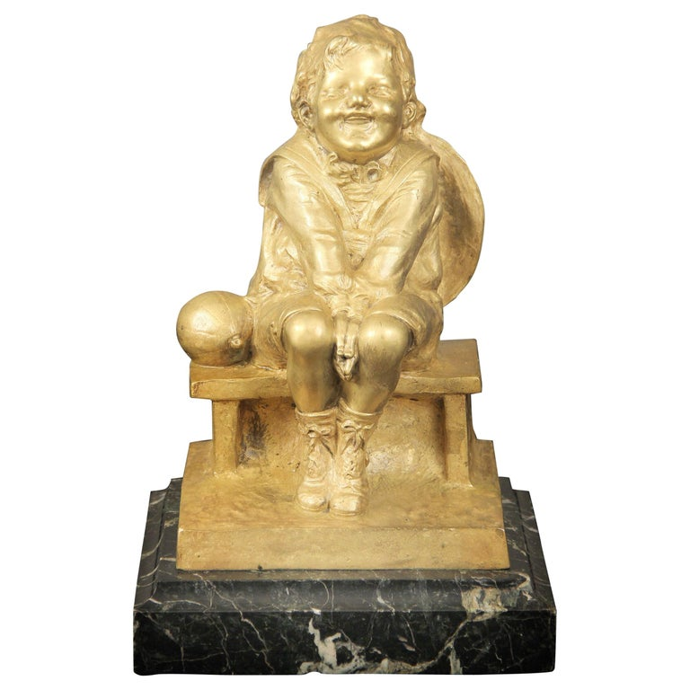 Nice Gilt Bronze Sculpture of a Child Seated on a Marble Base by Juan Clara For Sale