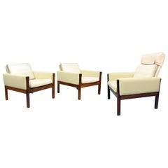 Three Lounge Chairs in Rosewood and Leather by Hans Wegner for A.P. Stolen