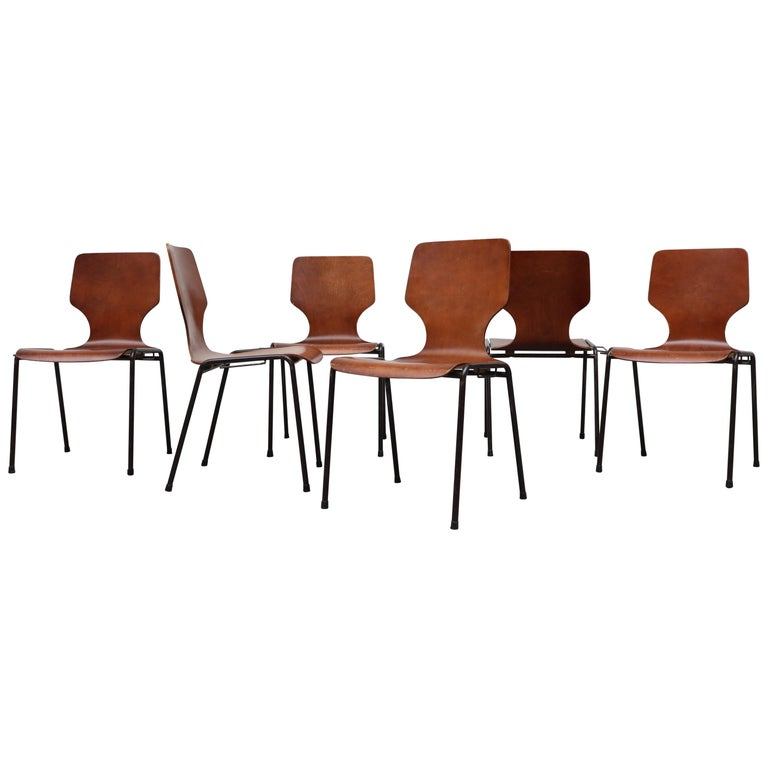 Handsome Fritz Hansen Style Wingback Stacking Dining Chairs For Sale