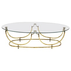 Modern Brass and Glass Oval Cocktail Table