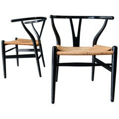 Pair of Ebonized Hans Wegner for Carl Hansen CH-24 Wishbone Chairs, circa 1960
