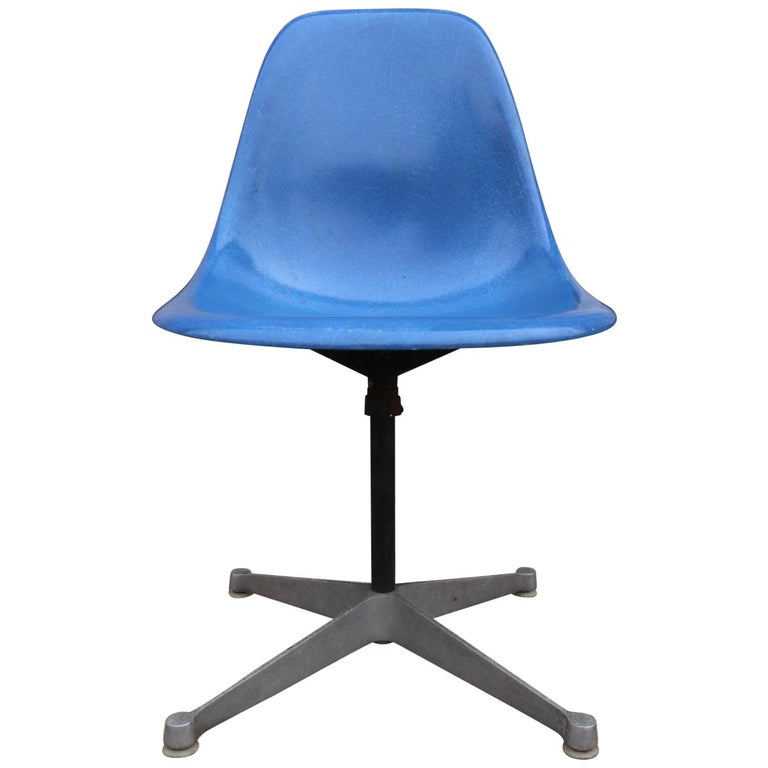 4 vintage Herman Miller Eames fiberglass chairs in swivels contract aluminum bases. All chairs have new rubber shockmounts ($700 value). All nylon foot glides present on bases to protect against scratching floor. Shells in very good vintage