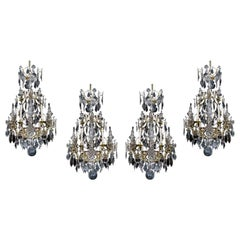 Set of Four Louis XV Style Six-Light Rock Crystal Cage Chandeliers, circa 1850