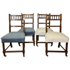 Set of Four Antique Carved Oak Chairs on Wheels