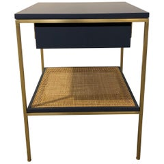 Re 392 Bedside Table in Kensington Blue on Satin Brass Frame with Caned Shelf