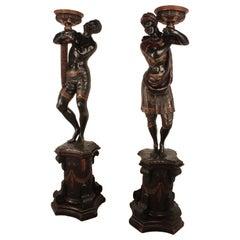 Pair of Ebonized Blackamoors on Pedestals