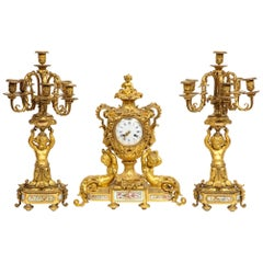 Exceptional French Ormolu-Mounted Porcelain Three-Piece Clock Garniture Set
