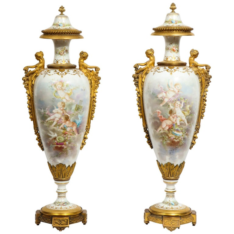 Monumental Pair of French Ormolu-Mounted White Sèvres Porcelain Vases and Covers For Sale