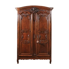 French Mid-18th Century Walnut Louis XV Lyonnaise Armoire with Carved Shell