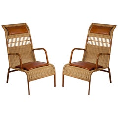 Pair of Stitched Leather and Rattan Armchairs by Jacques Adnet