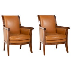 Pair of Louis Philippe Cognac Leather Bergeres
